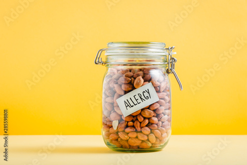 Glass jar full of peanuts with 'Allergy' sign in it Canvas Print