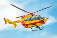 Red And Yellow Helicopter Of A...