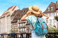 Backpacker Women Tourist Standing On A Beautiful Bridge Somewhere In Europe