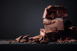 canvas print picture - Black chocolate on a dark background.
