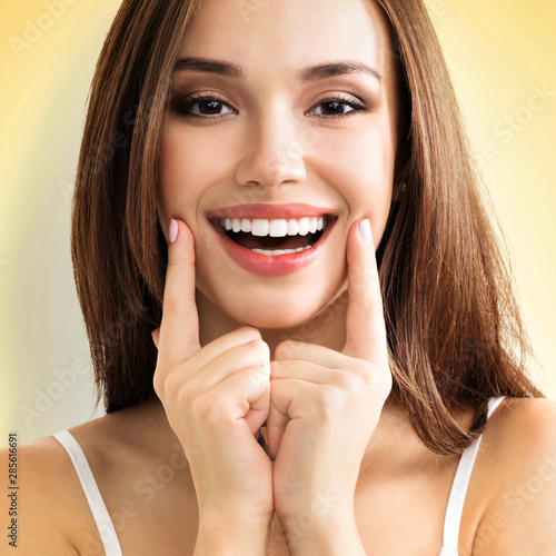 Woman showing toothy smile Canvas Print
