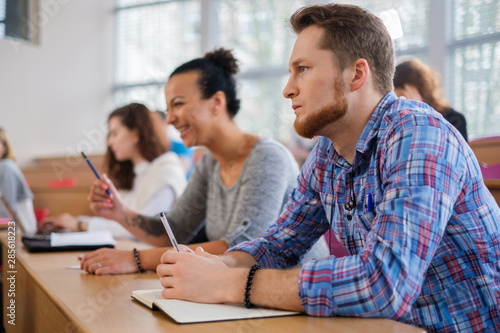 Fototapety, obrazy: Multinational group of students in an auditorium