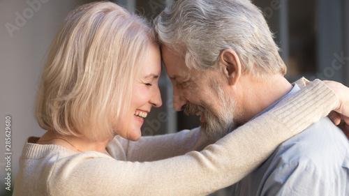 Canvas Print Loving old family couple bonding embracing enjoying moment of affection