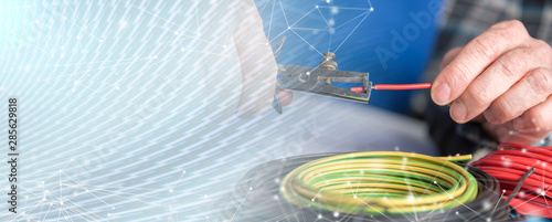Cuadros en Lienzo Electrician stripping a wire; multiple exposure