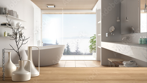 obraz dibond Wooden table top or shelf with minimalistic modern vases over blurred minimal luxuty bathroom with panoramic window, shower and bathtub, minimalist architecture interior design