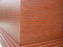 Corner Brown Brick Wall