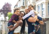 Fototapeta Londyn - Sweet family of four walking in the street