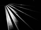 Fototapeta Na drzwi - street staircase with light and shadow, black and white style