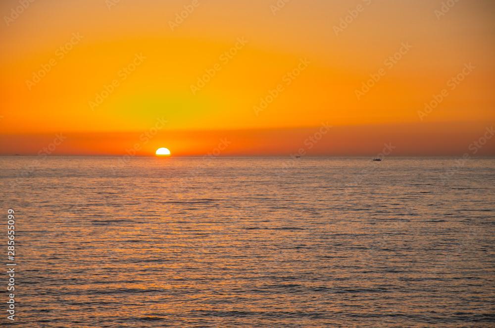 The sunset under the beautiful blue sky on beach