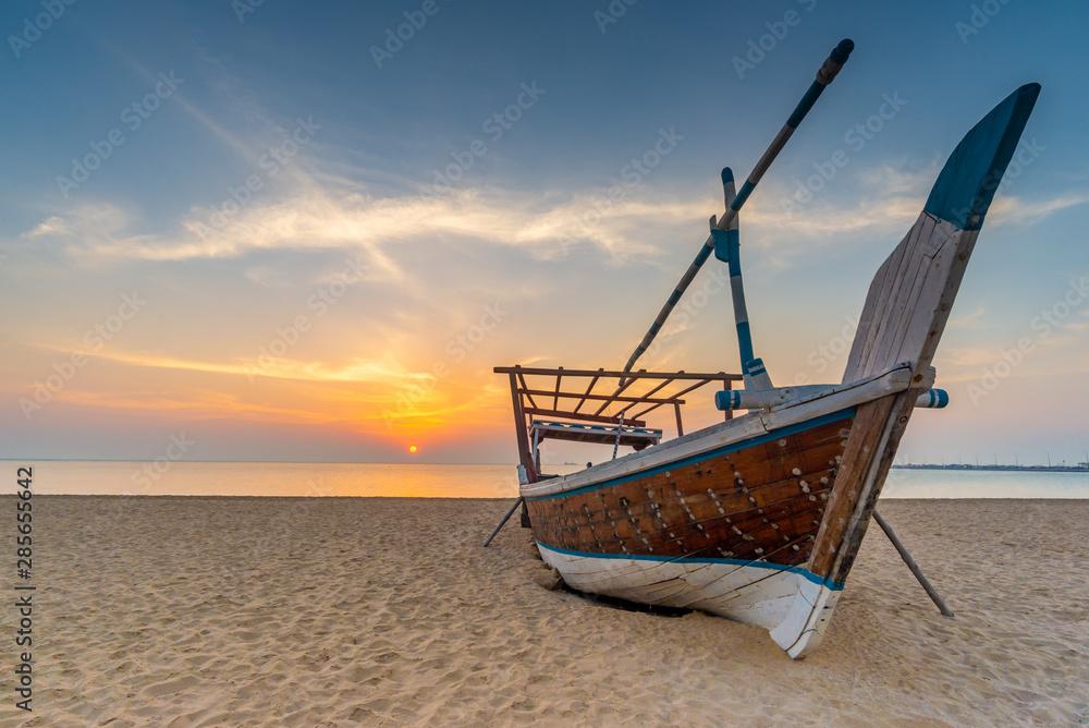 Fototapeta Traditional Arabian boat on a beach, Qatar