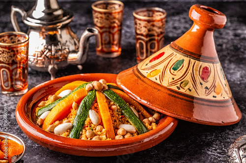 Obraz Vegetable tagine with almond and chickpea couscous. - fototapety do salonu