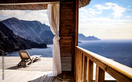 Wooden terrace and mountains landscape