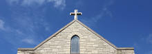 Cross On Church Steeple Of Old Christian Stone Temple