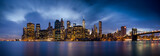 Fototapeta Nowy Jork - Downtown Manhattan skyline over East River at night in New York City
