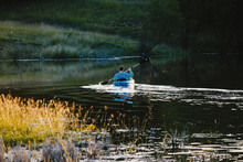 Kayaking Across Pond Water In Fall Texas Landscape.