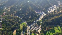 Aerial, Tilt Up, Drone Shot, Away From The Vermont Canyon Road, Buildings, The Park And The Griffith Observatory And Mount Hollywood, On A Sunny, Summer Day, In Los Feliz, Los Angeles, USA