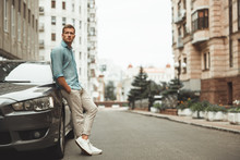 Young Handsome Man Standing Near His Parked Car