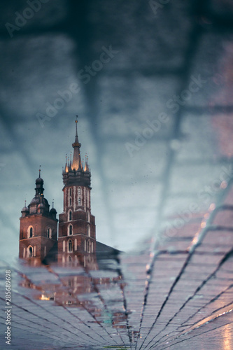 Fototapeta The main square Rynek Glowny old town Architecture. Reflection in a puddle. travel and tourism concept, central market square of Krakow, Poland Bazylika Mariacka. Krakow, Poland. vertical photo obraz