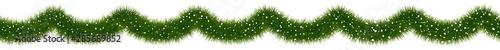 Fototapeta Festive Christmas fir garland covered with snow. obraz