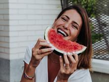 Caucasian Woman Eating Waterme...