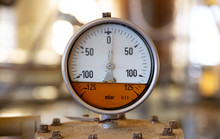 Industrial High Pressure Gas Meters, Pipelines And Valves On Blur Background