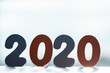 Happy New Year 2020. The number 2020 is written in wooden toy numbers. Beautiful card for the calendar.