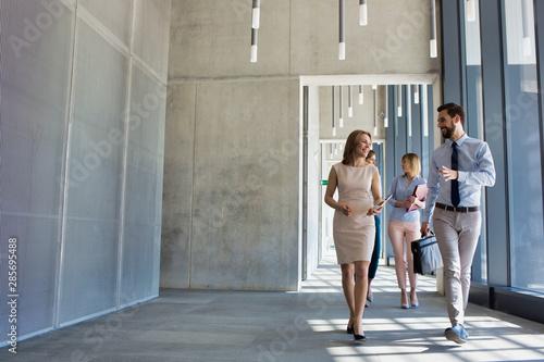 Stampa su Tela Business people walking in office corridor