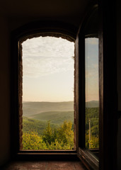 open window on the wall with Italian landscape