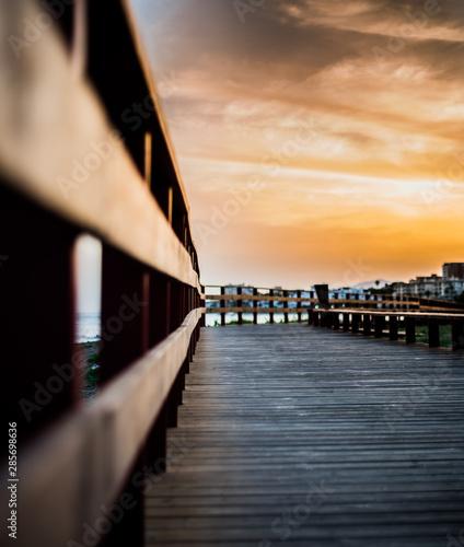 Fotobehang Meloen Beautiful sunset on maritime promenade of marbella