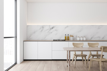 Marble and white kitchen, counters and table