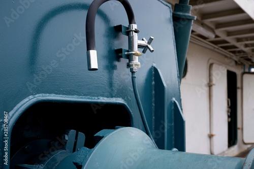 Spoed Foto op Canvas Muziekwinkel Selective focus at black water pipe for reduce heat of winch machine work in fishing vessel