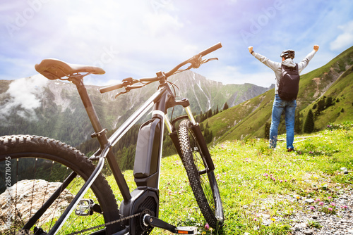 Man Enjoying View After Finishing Uphill Mountain Track Canvas