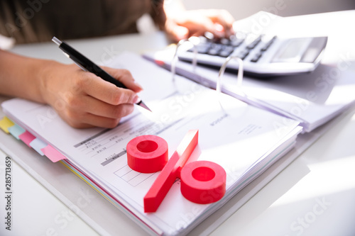 Businessperson's Hand Calculating Bill With Calculator Canvas Print