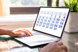 Businesswoman Looking At Calendar On Laptop - 285714208