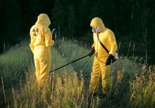 Two Dosimetrist  In Protective...