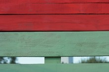 Green Red  Wooden Texture  Planks In The Wall Of The Fence