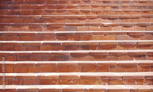 A close sectional full frame view of old red brick stairs