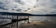 Lake Maraetai In Mangakino, Waikato District, New Zealand. Still Waters, Small Boat Jetty, Reflections Of Cloud And Sky. Moody, Peaceful, Reflective. Hydroelectric Station, Recreational Activities.