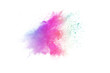 Freeze motion of colorful color powder exploding on white background. Paint Holi.