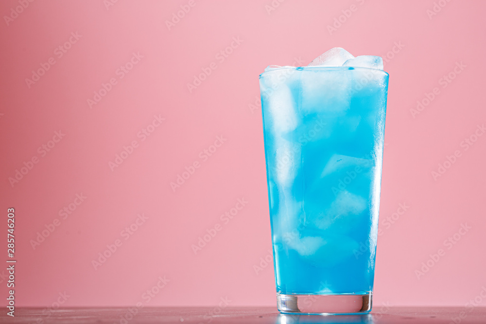 Fototapety, obrazy: Glass of a blue alcoholic cocktail drink with ice. Blue long drink cocktail alcoholic non-alcoholic cold beverage drink.