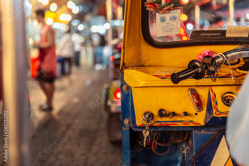 Riding Tuk Tuk at night in Bangkok, Thailand - popular among tourists city taxi Fototapet