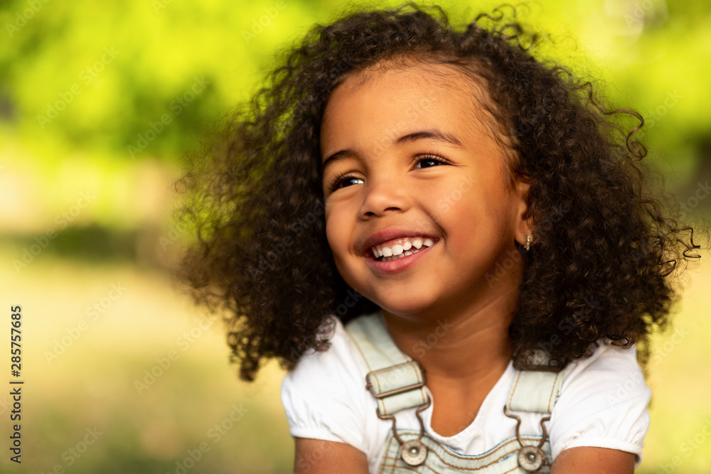 Fototapety, obrazy: Cute afro girl smiling broadly outdoors, having picnic with parents