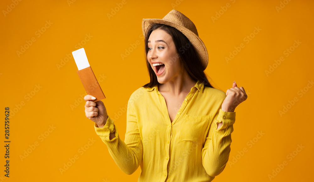 Fototapeta Happy Woman Traveler Holding Tickets And Passport, Studio Shot