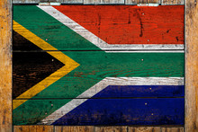 National Flag Of South African Republic On A Wooden Wall Background.The Concept Of National Pride And Symbol Of The Country.Flag Painted On A Wooden Fence With Metal Nails.