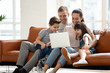 canvas print picture - Happy family enjoy using laptop make online call at home