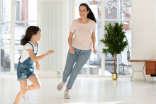 Happy Mom And Kid Daughter Playing Tag And Touch Game
