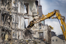 Dismantling Abandoned Building With Excavator