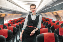 Caucasian Attractive Stewardess Is On Duty On Board Of Airplane
