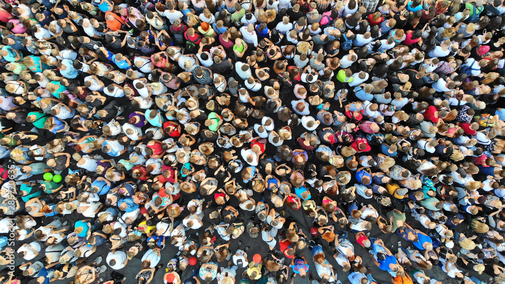 Fototapeta Aerial. People crowd background. Mass gathering of many people in one place. Top view.