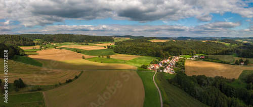 Foto auf Leinwand Dunkelgrau Panoramic view on an agricultural landscape near Stockach in Germany.